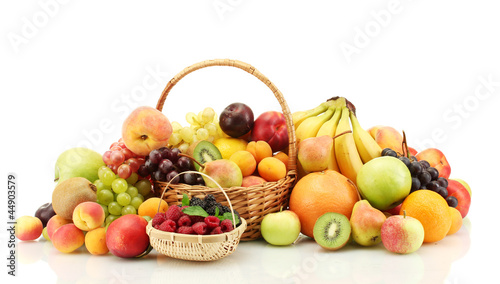 Keuken foto achterwand Vruchten Assortment of exotic fruits and berries in baskets isolated