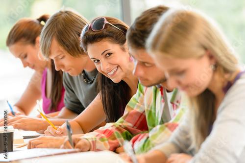 Fotografia  Students writing at high-school exam teens study