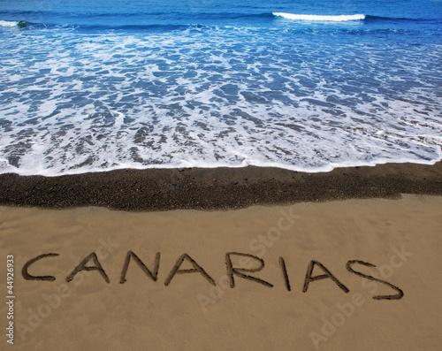 Fotografia  Brown beach sand with written word Canarias