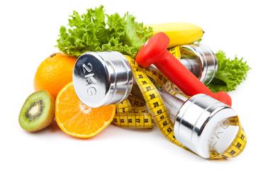 Fototapeta samoprzylepna fitness equipment and fruits