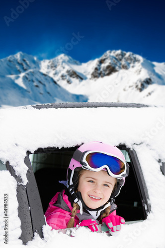 Fotobehang Wintersporten Winter holiday - happy child on the road for winter holidays