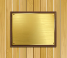 Brass Plaque On Wood Panel Bac...