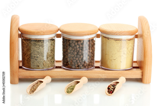 Foto op Canvas Kruiden 2 jars and wooden spoons with spices