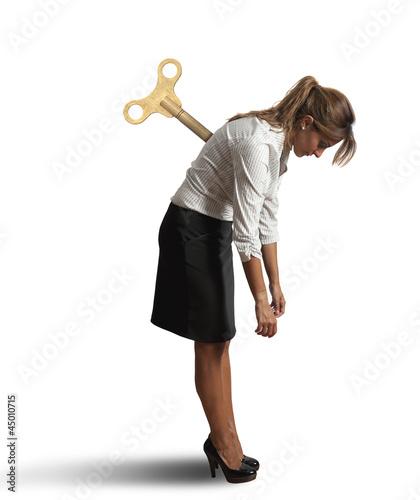 Foto  Tired businesswoman