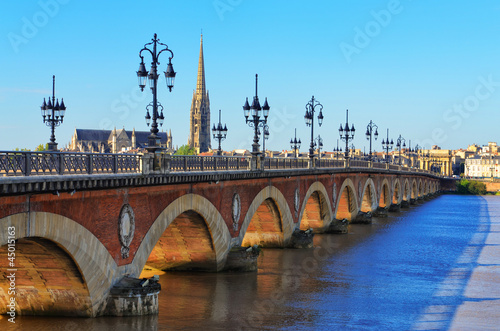 Aluminium Prints Blue Bordeaux river bridge with St Michel cathedral