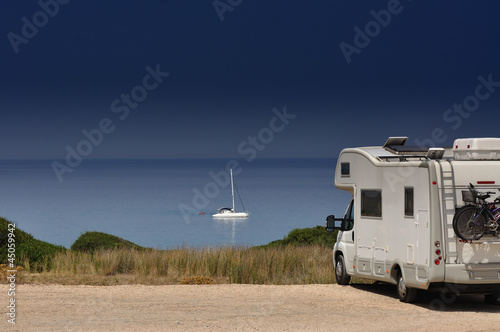 Camper van on the beach Plakat