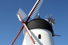 Windmill Against A Blue Sky On...