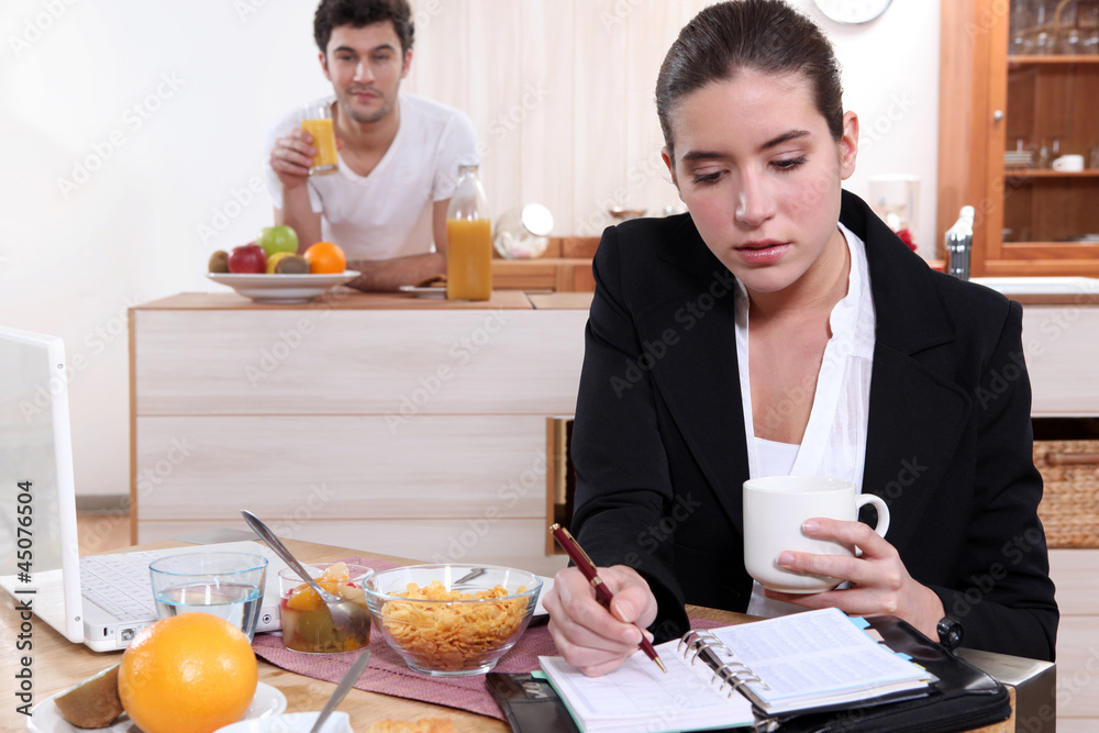 Fototapeta Couple eating breakfast separately