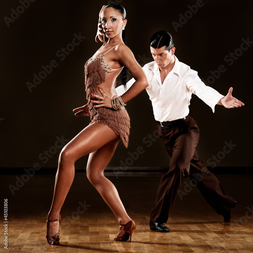 latino dance couple in action - 45103806