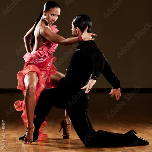 latino dance couple in action - 45104017