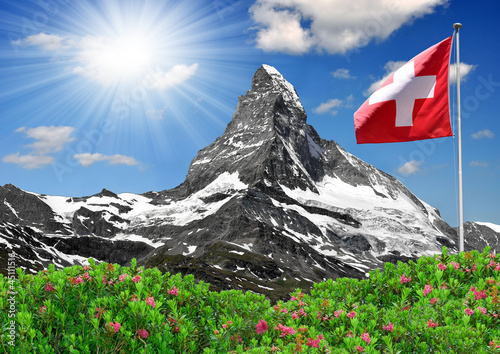 Fotografie, Obraz  Beautiful mountain Matterhorn with Swiss flag - Swiss Alps