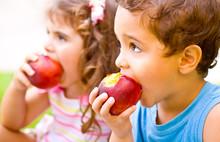 Happy Children Eating Apple