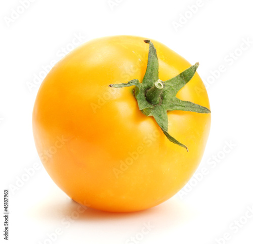 yellow tomato isolated on white
