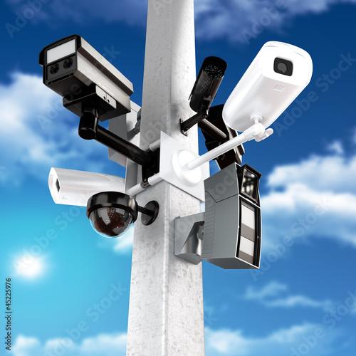 Fotografie, Obraz  Surveillance mega camera's concept with a sky background