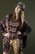 fashion model woman in hat posing dark background