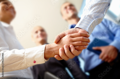 Photo Business handshake and business people