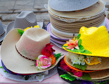 Colorful Straw Hats Stacked In An Outdoor