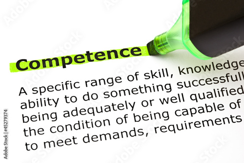 Fotografía  Dictionary definition of the word Competence highlighted in green