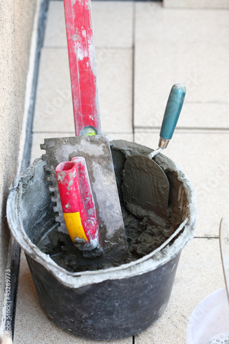 Photo  mortar on wall construction notched trowel