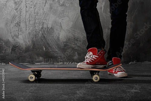 Legs in sneakers on a skateboard