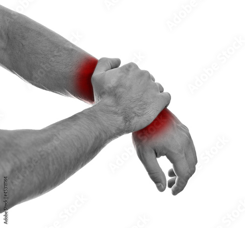 Poster Red, black, white Close up view of male hands with wrist pain. Isolated