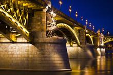 Beautifully Lit Margaret Bridge Over The Danube At Dusk In Budap