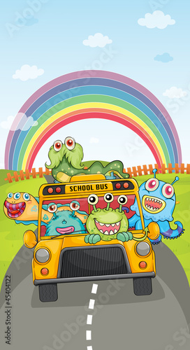 Foto op Aluminium Schepselen monsters, school bus and rainbow