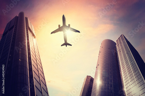 Airplane over a Big City Wallpaper Mural