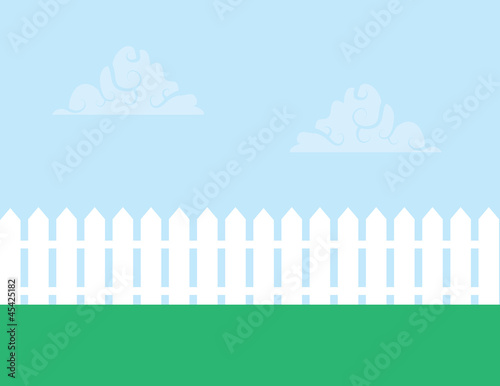 Fotografía White picket fence with cloudy sky