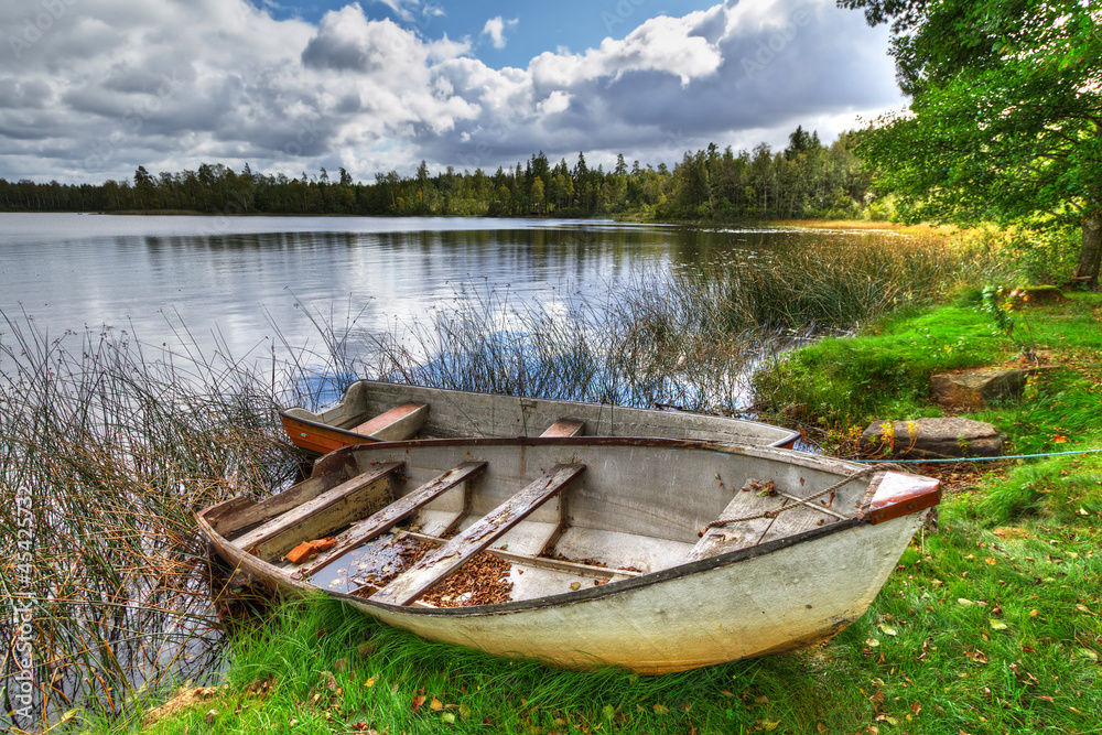 Fototapeta Swedish lake with boat in summer time