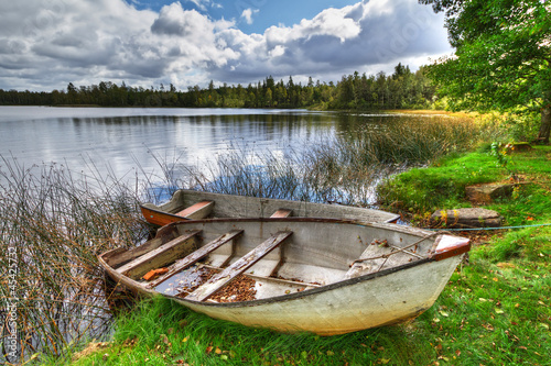 Fototapety, obrazy: Swedish lake with boat in summer time