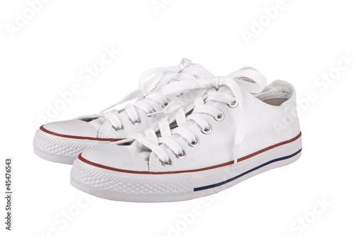 Fotografia  Pair of new white sneakers on white background