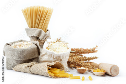 Fotografie, Obraz  Flour, cereals, pasta in a canvas bag and ear on white backgroun