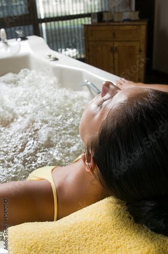 Fényképezés  Beautiful young woman relaxing in jacuzzi