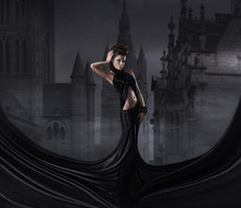 Fashion Shoot Of A Woman In A Long Dress On A Spooky Background