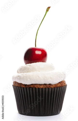 Fotografia Cupcake with whipped cream and cherry