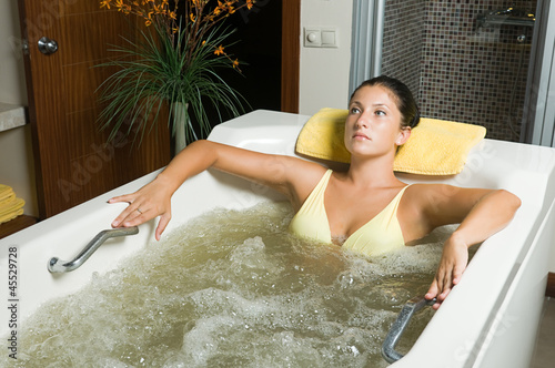 Beautiful young woman relaxing in jacuzzi Canvas-taulu
