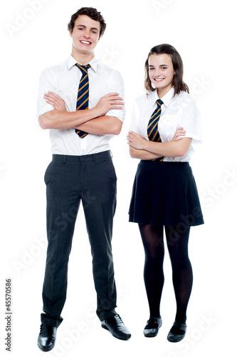 Fotografía  Students in uniform posing with arms crossed