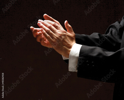 Male hands clapping on black, side-view Wallpaper Mural