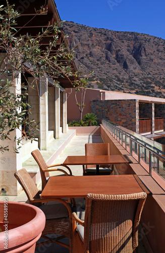 Fototapeta outdoor terrace with chairs and table(Greece) obraz na płótnie