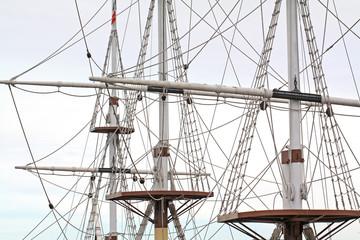Fototapetaship masts on cloudy background
