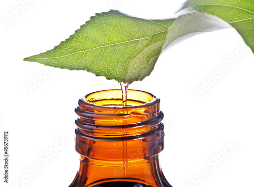 Photo  bottle with homeopathy balm and leaf