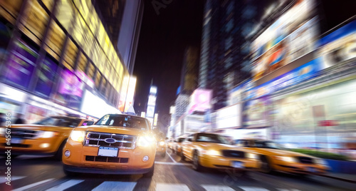 Fototapeta New York Taxi on Time Square in the night
