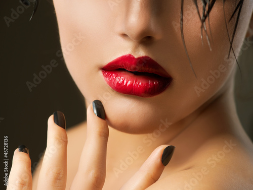 Fashion Girl Closeup. Red Lips And Black Nails. Beautiful Makeup