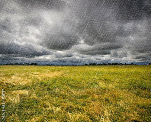 Papiers peints Tempete Heavy Rain over a prairie in Brittany, France