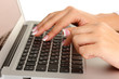 business woman's hands typing