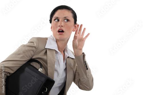 Photo Businesswoman listening in shock