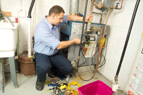 Fotografie, Obraz Plumber repairs furnace