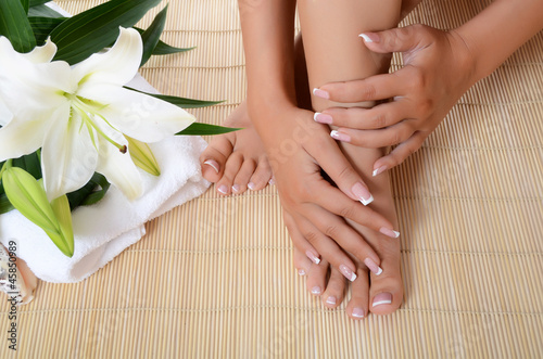 Staande foto Manicure Woman hand and feet with manicure