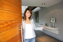 Woman Opening Her House Door To Welcome People